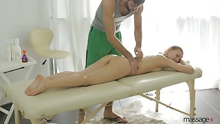 After giving BJ during rub-down babe with juicy ass Sabrina Moore rides dick