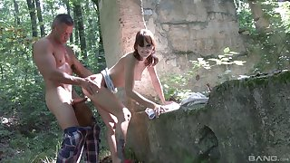 Brunette teen Suzi Rainbow bent over and pounded in get under one's forest