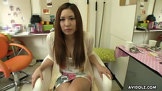 Swanky Japanese babe Ai Koda gets her pussy toyed in a hair salon
