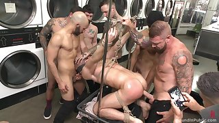 Gay orgy at the laundromat set to repeal surrounding a bang