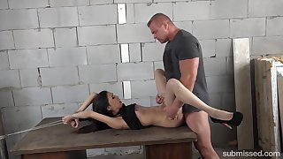 Submissive doll acts wild with cock in both her holes